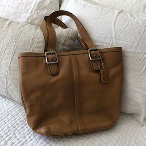 Coach camel colored leather purse.